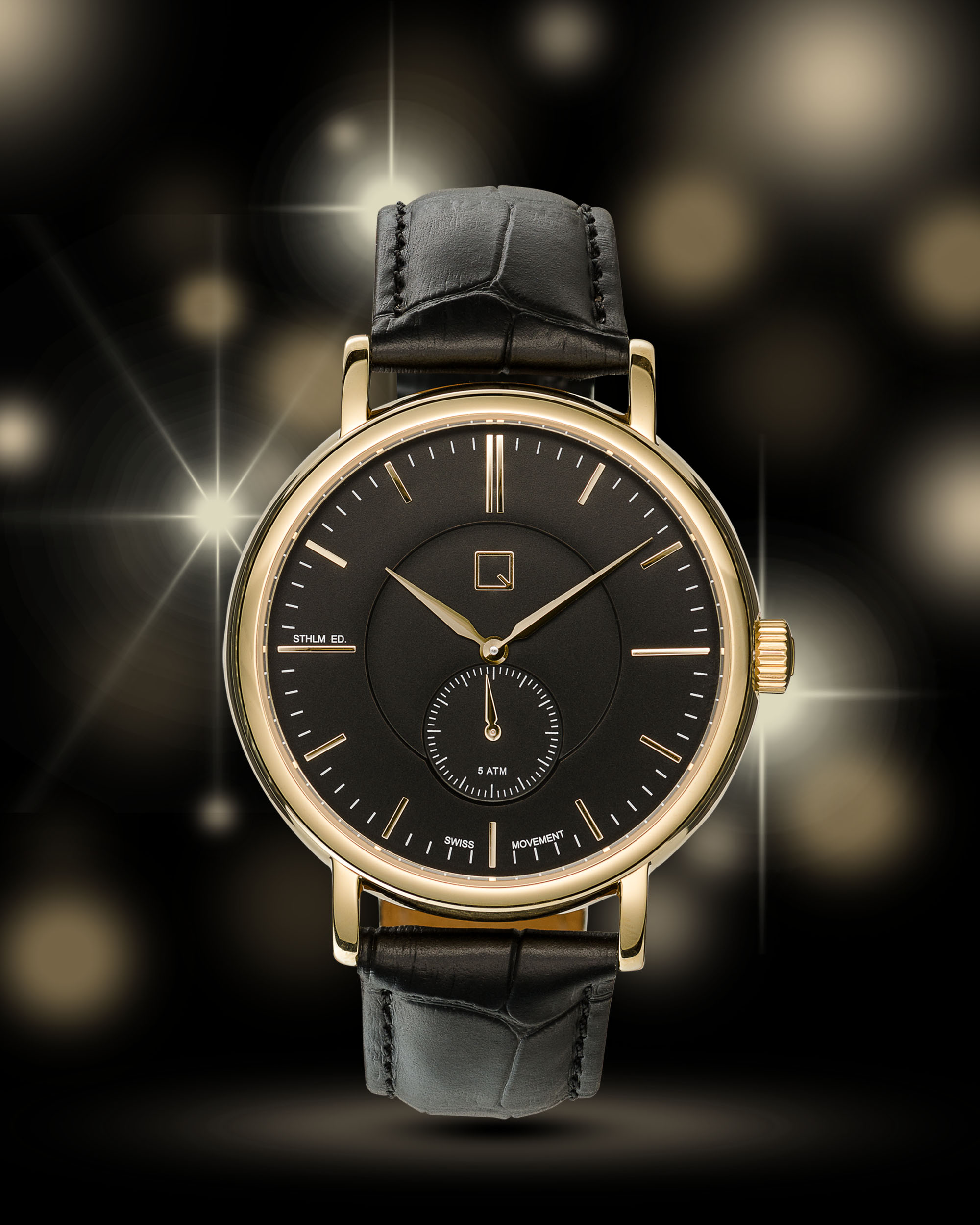 Ian Knaggs Commercial Watch Photographer - Black Watch with Gold Stars