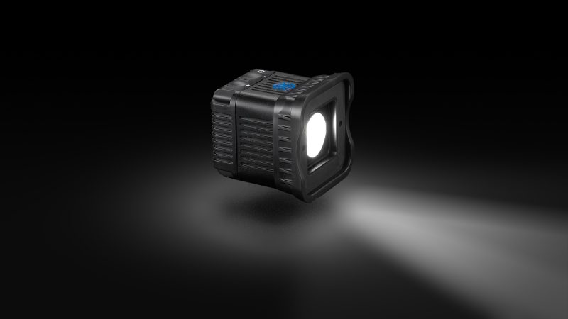 Front view of Lume Cube on black background with lightbeam